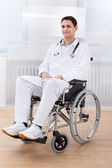 Handicapped Doctor Sitting On Wheel Chair In Hospital — Stockfoto