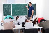 Teacher Teaching Mathematics To Bored Students — Стоковое фото