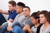 Happy College Student Sitting With Classmates — Stock Photo