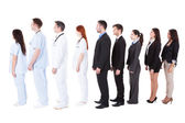 Doctors and managers standing in queue — Stock Photo