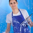Male Servant Cleaning Glass With Squeegee — Stock Photo