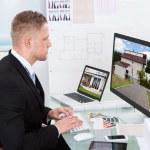 Businessman checking a property portfolio online — Stock Photo
