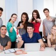 Student Holding Degree With Classmates Gesturing Thumbs Up — Stock Photo