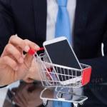 Businessman Pushing Smartphone In Shopping Cart — Stock Photo #44070969