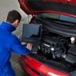 Mechanic Using Laptop While Repairing Car — Stockfoto
