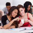 Happy female college students using mobile phone together — Stockfoto #44071503