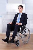 Confident Businessman Sitting On Wheelchair — Stock Photo