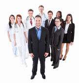 Boss standing on front of his team — Stock Photo