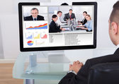 Businessman Video Conferencing With Team — Stock Photo