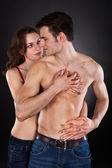 Woman Seducing Man Over Black Background — Stock Photo