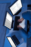 Hacker Using Multiple Computers To Steal Data — Stock Photo