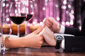 Couple Holding Each Other's Hand At Dinner — Stock Photo