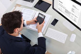 Businessman Calculating Tax — Stock Photo