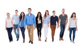 Diverse group of people walking towards camera — Stock Photo