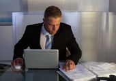 Businessman under pressure working overtime — Stock Photo