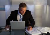 Businessman under pressure working overtime — Stock Photo