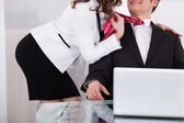 Businesswoman Pulling Male Colleague's Tie While Seducing Him — Stock Photo
