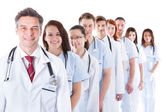 Long line of smiling doctors and nurses — Stock Photo