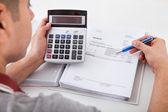 Man Calculating Financial Expenses At Home — Stock Photo