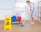 Happy Maid Cleaning Floor With Mop — Stock Photo