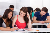 Happy Female Students Studying In Classroom — Stock Photo