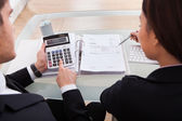 Business People Calculating Tax — Stock Photo