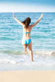 Woman In Bikini Jumping On Beach — Stock Photo