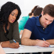 Female College Student Sitting In Classroom — Stock Photo #44588783
