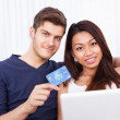 Portrait Of Couple Shopping Online At Home — Stock Photo #44588803