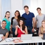 University Student Holding Degree In Classroom — Stock Photo #44588937