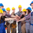 Diverse group of construction workers stacking hands — Stock Photo #44589707