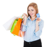 Woman With Shopping Bags Holding Credit Card — ストック写真