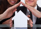 Business People Covering House Model — Stock Photo