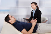 Psychologist Writing Notes While Patient Lying On Bed — Stock Photo