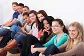 Confident University Students Sitting In A Row — Stock Photo