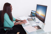 Editor Using Digital Tablet At Photo Agency — Stock Photo