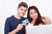 Portrait Of Couple Shopping Online At Home — Stock Photo