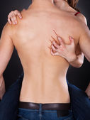 Passionate Woman's Hand Scratching Shirtless Man's Back — Stock Photo