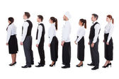 Waiters and waitresses standing in queue — Stock Photo