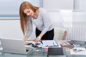 Young Woman Choosing Color — Stock Photo