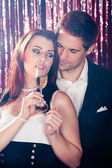 Couple Enjoying Champagne At Nightclub — Stock Photo