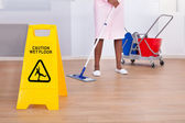 Female Housekeeper Cleaning Floor In Hotel — Stock Photo