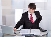 Businessman Suffering From Backache At Desk — 图库照片