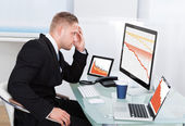 Despairing businessman faced with financial losses — Stock Photo