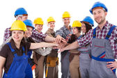 Diverse group of construction workers stacking hands — Stock Photo