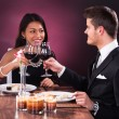 Couple Toasting Wineglasses At Restaurant Table — Stock Photo #44590329