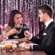 Couple Toasting Wineglasses At Restaurant Table — Stock Photo #44590643