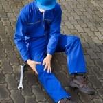 Technician Suffering From Knee Pain On Street — Stock Photo #44590855