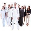 Doctor standing in front of his team — Stock Photo