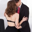 Businesswoman Seducing Boss In Office — Stock Photo #44591485